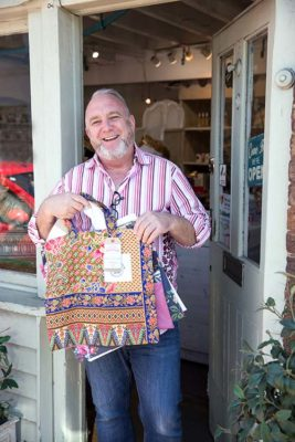 Shop keeper with Boomerang Bags