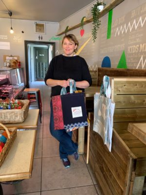 Lady Shop keeper with Boomerang Bags